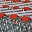 Shopping carts row closeup - Stock Photo