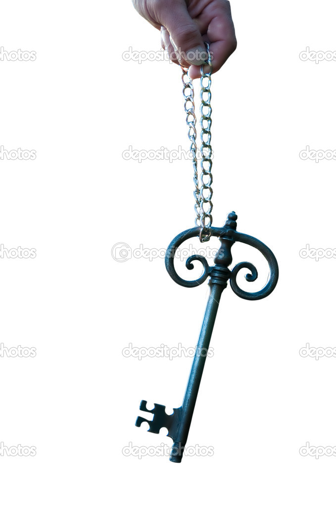 And old big sunlit key held with a chain — Stock Photo #2586026