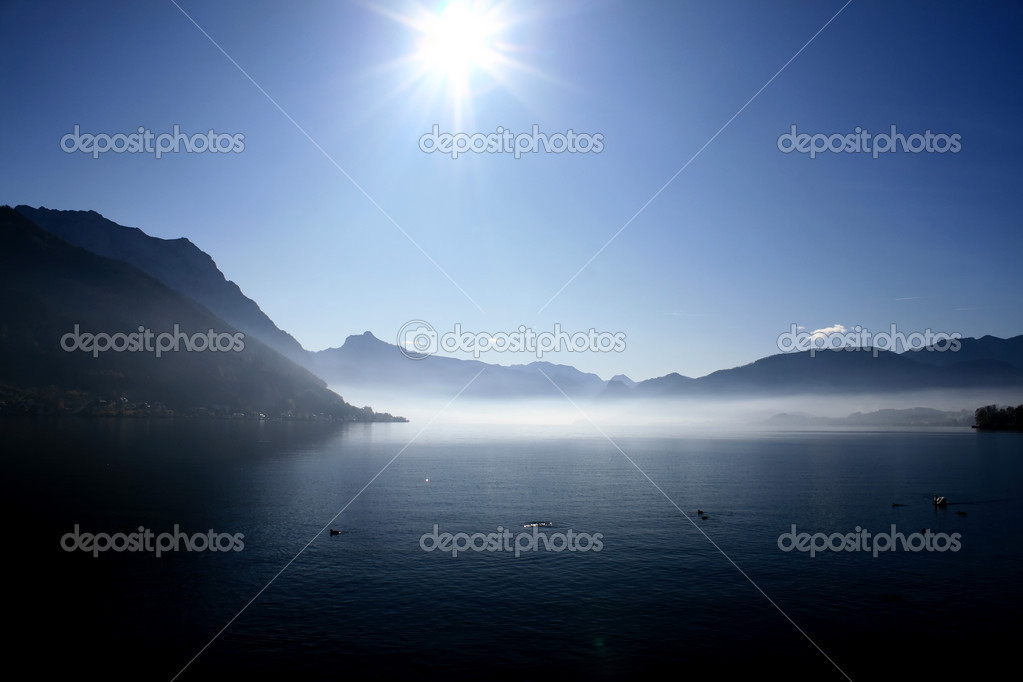 Mountain landscape, lake and fog, mist, sun — Stock Photo #1798801