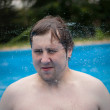 Young boy, man in swimming pool — Stock Photo