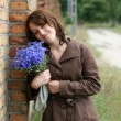 Stock Photo: Young womwith flowers
