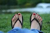 Red toe-nails, woman feet — Stock Photo