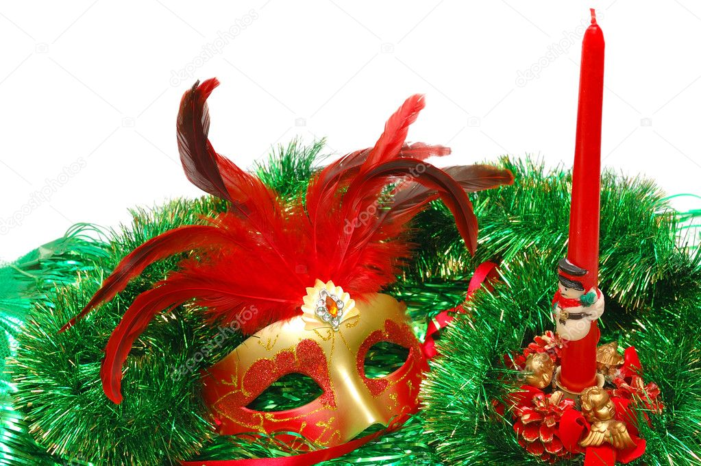 Carnival mask on a green New Year's ornament on white — Stock Photo #1858752