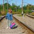 Stock Photo: Little girl going on railway