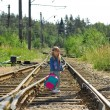 Little girl going on railway — Stock Photo