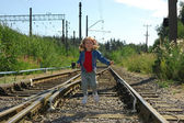 The little girl jumping on railway rails — Stock Photo