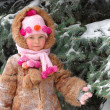 Girl in winter clothes at a snow pine - Stockfoto