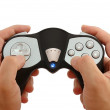 Hands with the game controller on white — Stock Photo