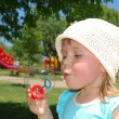 The girl blows a soap bubble — Stock Photo #1961258