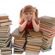 Girl in an environment of books on white — Stock Photo