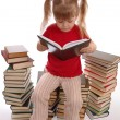 Stock Photo: The little girl reads the book