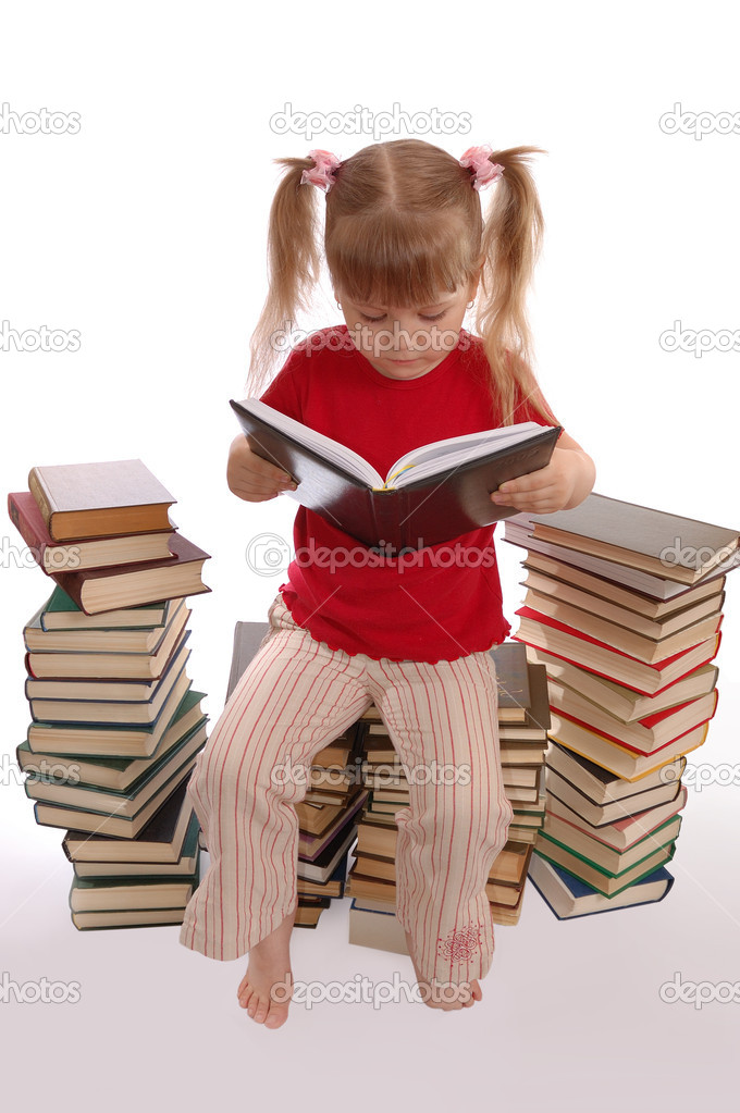 The little girl reads the book  Stock Photo #2076289