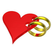 Two gold wedding rings with red heart — Stock Photo