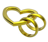 Two gold wedding rings with gold heart — Stock Photo