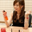 Chinese lady applying moisture spray — Stock Photo #2514603