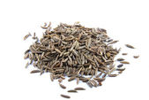 Cumin on white background — Stock Photo