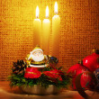 Santa in candles light - Stock Photo
