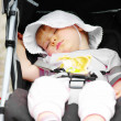Sleeping baby into baby carriage — Stock Photo