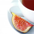 Tea cup and fig fruit — Stock Photo