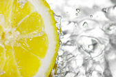 Fresh water drops on lemon — Stock Photo