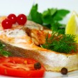 Fish dish - grilled fish with vegetables - Stock Photo
