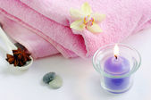 Spa concept with candles orchids towels — Stock Photo