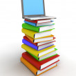 Laptop on Stack of Books - Stock Photo