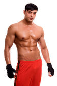 Portrait of young bodybuilder man isolated on white. — Stock Photo