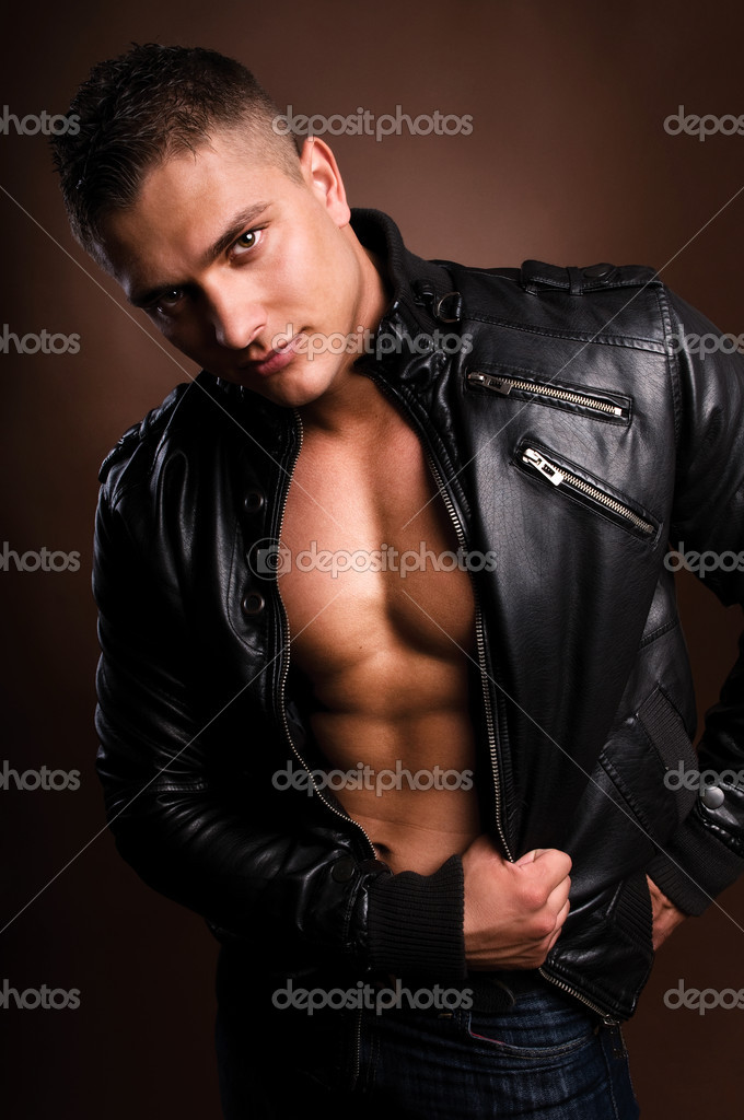 Portrait of young man in a leather jacket. — Stock Photo #2033856