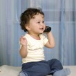 Baby with telephone. — Stock Photo