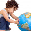 Child with globe. - Foto de Stock