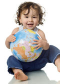 Baby with puzzle globe. — Stock Photo