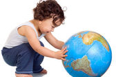 Child with globe. — Stock Photo