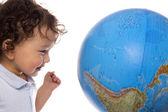 Child with globe. — Stock Photo