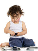 Child with mobile phones. — Stock Photo