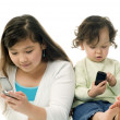 Stock Photo: Children with mobile phones.