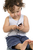 Child with mp 3 player. — Stock Photo