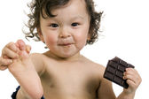 Child with chocolate. — Stock Photo