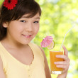 Girl with juice — Stock Photo #2485324