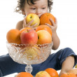Baby with fruits. — Stock Photo #2489075