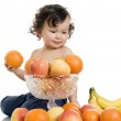 Baby with fruits. — Stock Photo