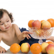 Baby with fruits. — Stock Photo #2489107