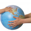 Globe in baby's hands. — Stock Photo