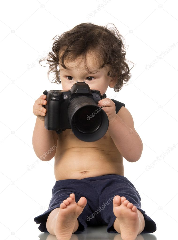 Baby with camera, isolated on a white background. — Stock Photo #2593253
