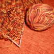 Orange balls of yarn and spades for knitting — Foto Stock