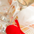 Two glasses of champagne with red fabric heart — Stock Photo #1852231