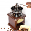 Coffee grinder with beans isolated on white — Stok fotoğraf