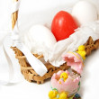 Royalty-Free Stock Photo: Basket with red and white eggs and chickens figures