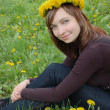 Beautiful girl with dandelion diadem — Stock Photo #1856411