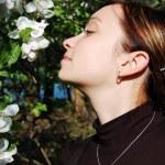 Beautiful woman among blooming cherry tree — Stock Photo #1859545